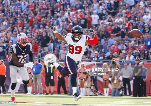 Devin McCourty of the New England Patriots defends as Stephen Anderson of the Houston Texans reaches for an overthrown pass during the fourth quarter...