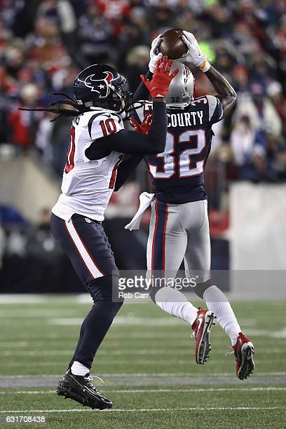 Devin McCourty of the New England Patriots intercepts a pass intended for DeAndre Hopkins of the Houston Texans in the third quarter during the AFC...