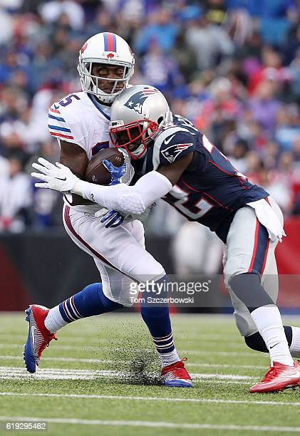 Devin McCourty of the New England Patriots puts a hard hit on Brandon Tate of the Buffalo Bills during the second half at New Era Field on October 30...