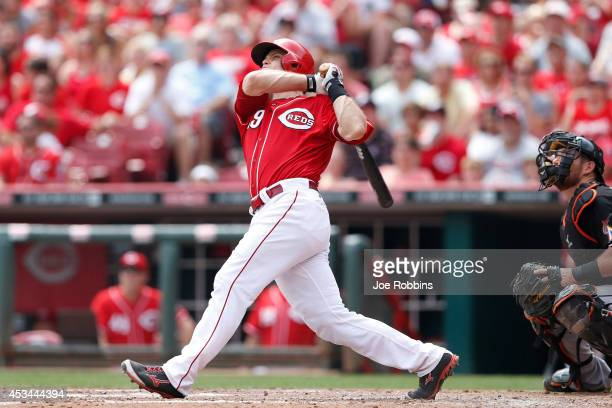 Devin Mesoraco of the Cincinnati Reds follows through on a grand slam home run in the fifth inning of the game against the Miami Marlins at Great...