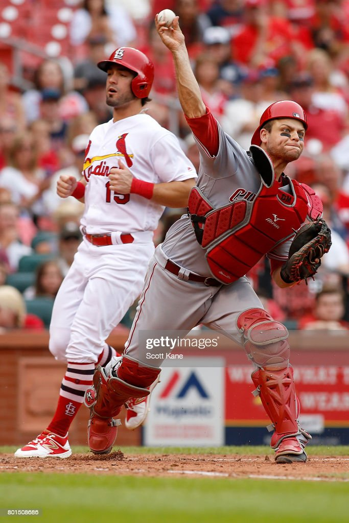 Devin Mesoraco #39 of the Cincinnati Reds throws to first for a double play after making an out against Randal Grichuk #15 of the St. Louis Cardinals during the sixth inning at Busch Stadium on June 26, 2017 in St. Louis, Missouri.