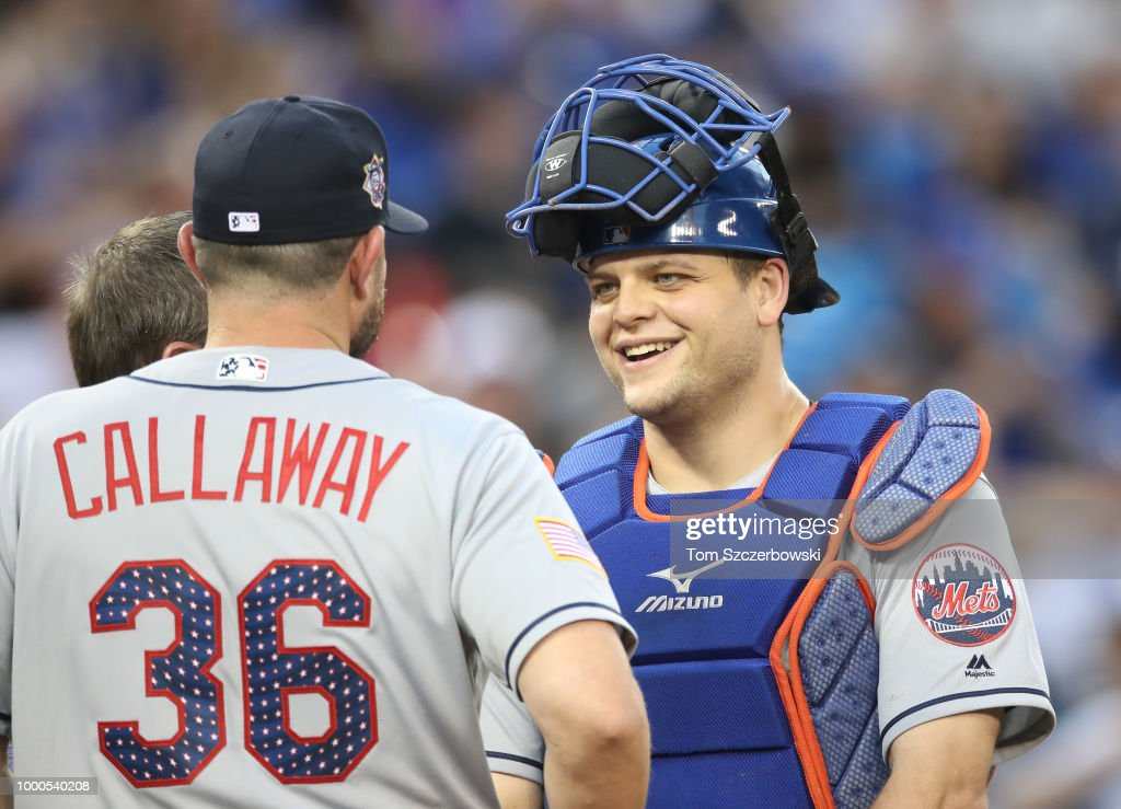 Devin Mesoraco #29 of the New York Mets shares a laugh with manager Mickey Callaway #36 during a visit to the mound in the fifth inning during MLB game action against the Toronto Blue Jays at Rogers Centre on July 3, 2018 in Toronto, Canada.