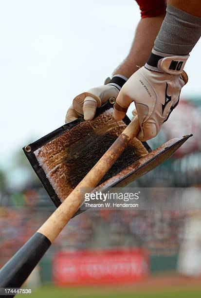 Devin Mesoraco puts pinetar on the handle of his bat in the second inning against the San Francisco Giants at ATT Park on July 23 2013 in San...