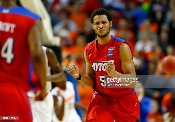 Devin Oliver of the Dayton Flyers celebrates against the Syracuse Orange during the third round of the 2014 NCAA Men's Basketball Tournament at the...