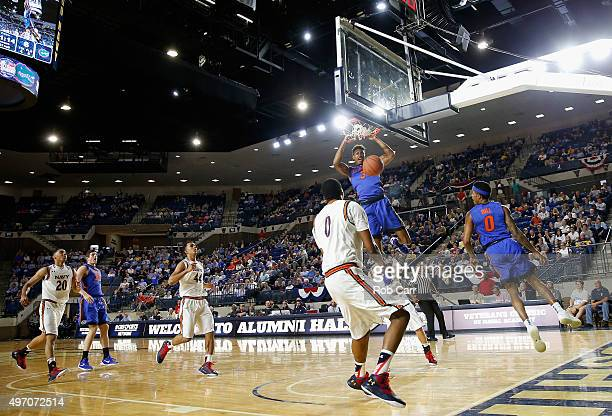Devin Robinson of the Florida Gators dunks against the Navy Midshipmen in the first half during the Veterans Classic at Alumni Hall on November 13...