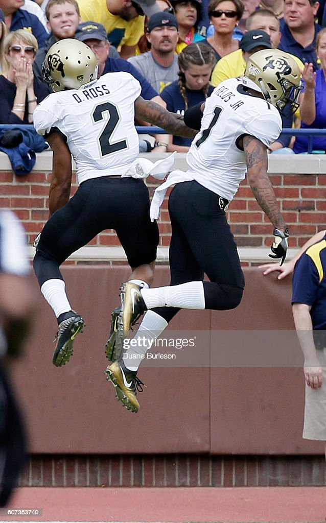 Devin Ross #2 of the Colorado Buffaloes celebrates his first quarter touchdown against the Michigan Wolverines with Afolabi Laguda #1 of the Colorado Buffaloes at Michigan Stadium on September 17, 2016 in Ann Arbor, Michigan. Michigan defeated Colorado 45-28.