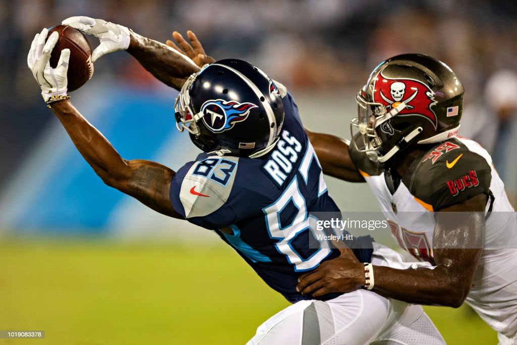 Devin Ross #83 of the Tennessee Titans catches a pass while being defended by Isaiah Johnson #39 of the Tampa Bay Buccaneers at Nissan Stadium during week 2 of the preseason on August 18, 2018 in Nashville, Tennessee. The Buccaneers defeated the Titans 30-14.