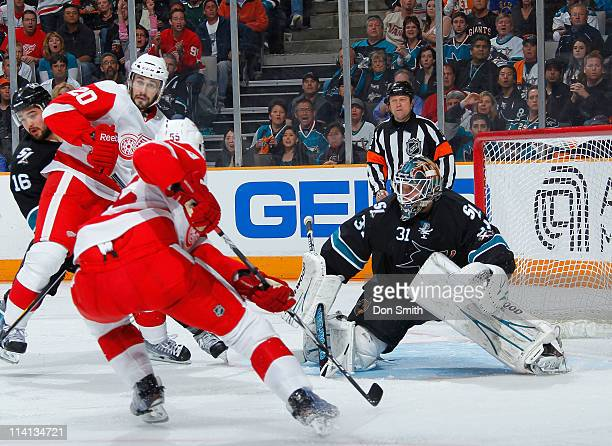 Devin Setoguchi and Antti Niemi of the San Jose Sharks defend the net against Drew Miller and Niklas Kronwall of the Detroit Red Wings in Game Seven...