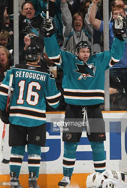 Devin Setoguchi and Dany Heatley of the San Jose Sharks celebrate Heatley's goal during an NHL game against the Anaheim Ducks on December 26, 2009 at...