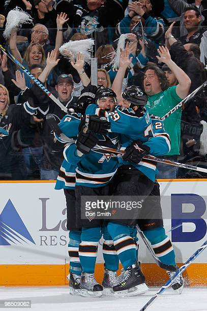 Devin Setoguchi of the San Jose Sharks celebrates his overtime gamewinning goal with teammates Joe Pavelski and Ryane Clowe in Game Two of the...