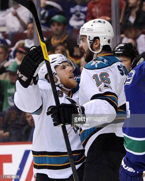 Devin Setoguchi of the San Jose Sharks celebrates with teammate Joe Pavelski after scoring in the third period against the Vancouver Canucks in Game...