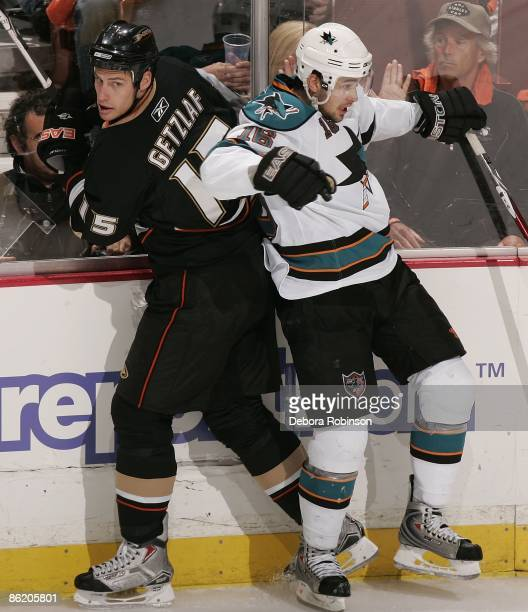 Devin Setoguchi of the San Jose Sharks checks Ryan Getzlaf the Anaheim Ducks into the boards during Game Four of the Western Conference Quarterfinal...
