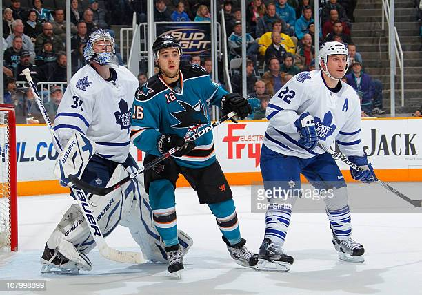 Devin Setoguchi of the San Jose Sharks looks for the puck against Francois Beauchemin and James Reimer of the Toronto Maple Leafs during an NHL game...