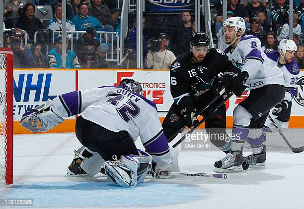 Devin Setoguchi of the San Jose Sharks pursues the puck against Jonathan Quick, Drew Doughty and Willie Mitchell of the Los Angeles Kings in Game 5...