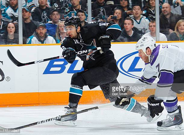 Devin Setoguchi of the San Jose Sharks takes a shot against Rob Scuderi of the Los Angeles Kings in Game 1 of the Western Conference Quarterfinals...