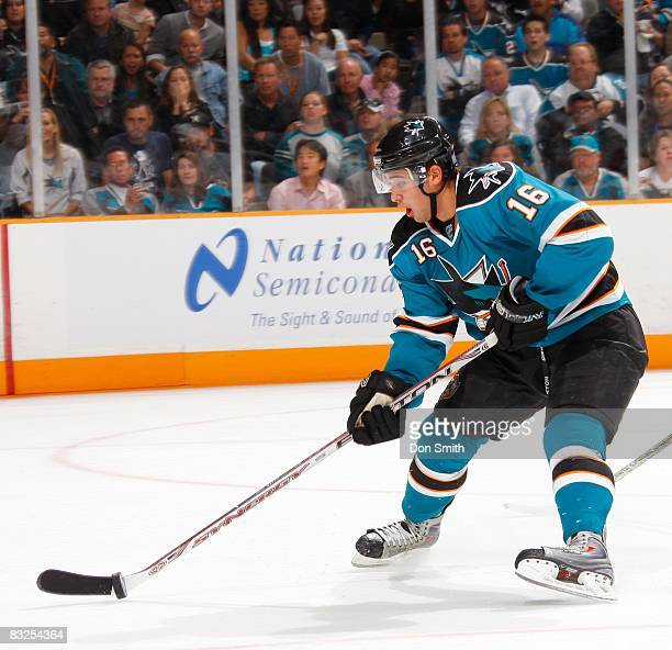 Devin Setoguchi of the San Jose Sharks tries to control the puck during an NHL game against the Anaheim Ducks on October 9 2008 at HP Pavilion at San...