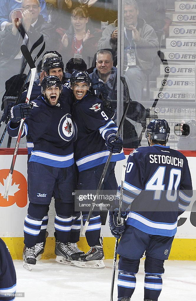 Devin Setoguchi #40 of the Winnipeg Jets joins teammates Eric O'Dell #58, Adam Pardy #2 and Evander Kane #9 after a second-period goal against the Colorado Avalanche at the MTS Centre on March 19, 2014 in Winnipeg, Manitoba, Canada.