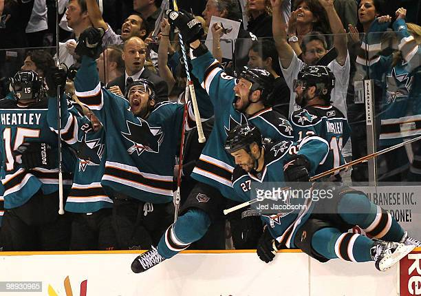 Devin Setoguchi Ryan Clowe and Manny Malhotra of the San Jose Sharks celebrate after defeating the Detroit Red Wings in Game Five of the Western...