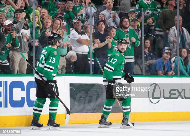 Devin Shore Mattias Janmark and the Dallas Stars celebrate a goal against the St Louis Blues at the American Airlines Center on March 3 2018 in...