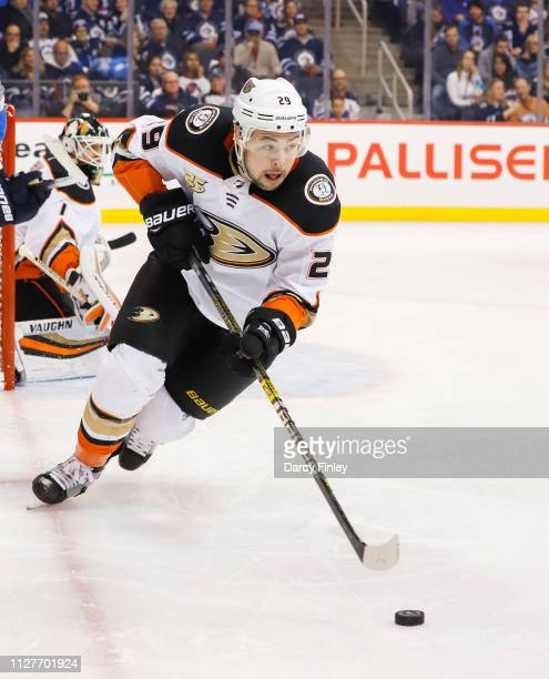 Devin Shore of the Anaheim Ducks plays the puck up the ice during second period action against the Winnipeg Jets at the Bell MTS Place on February 2...