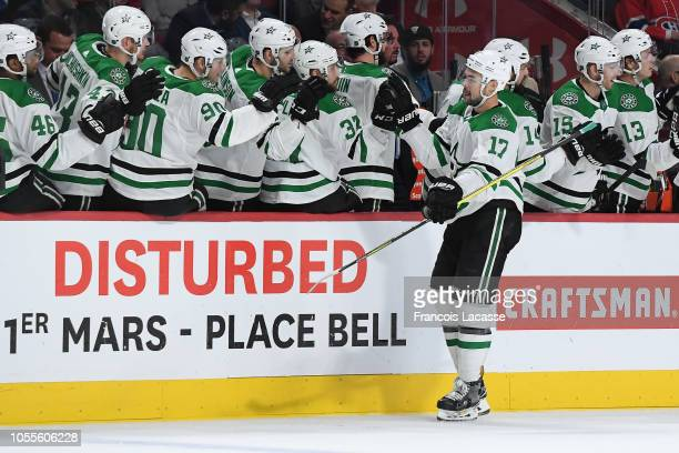 Devin Shore of the Dallas Stars celebrates with the bench after scoring a goal against the Montreal Canadiens in the NHL game at the Bell Centre on...