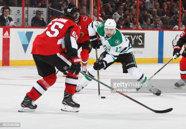 Devin Shore of the Dallas Stars stickhandles the puck against Erik Karlsson of the Ottawa Senators at Canadian Tire Centre on March 16 2018 in Ottawa...