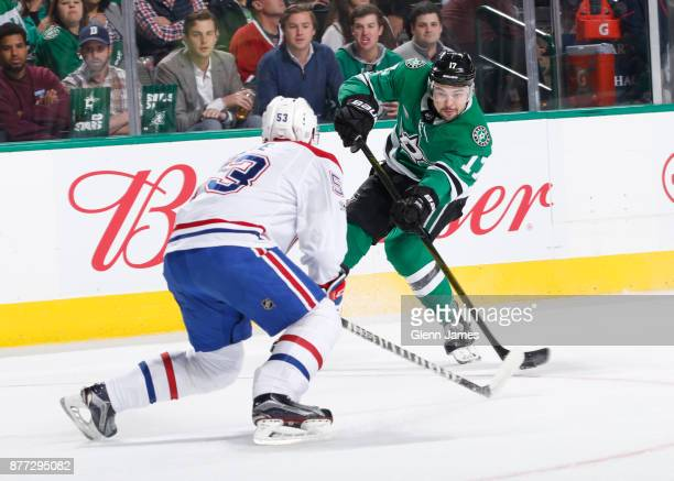 Devin Shore of the Dallas Stars takes a shot against Victor Mete of the Montreal Canadiens at the American Airlines Center on November 21 2017 in...