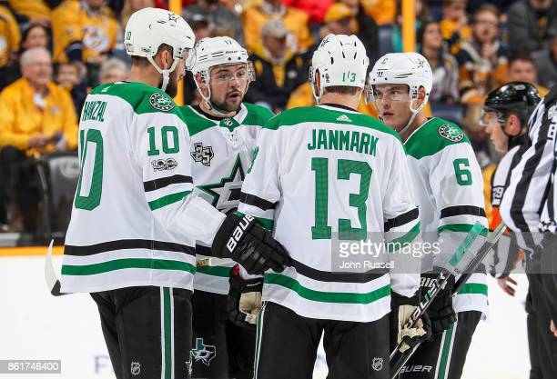 Devin Shore talks with Julius Honka Mattias Janmark and Martin Hanzal of the Dallas Stars during a stoppage in play against the Nashville Predators...
