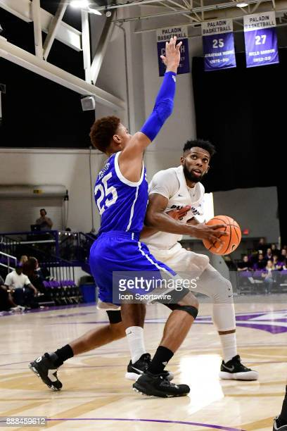 Devin Sibley guard Furman University Paladins challenges MaCio Teague guard UNC Asheville Bulldogs Tuesday December 5 at Timmons Arena in Greenville...