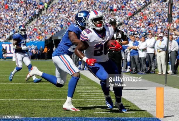 Devin Singletary of the Buffalo Bills runs in a touchdown against Deandre Baker of the New York Giants at MetLife Stadium on September 15 2019 in...