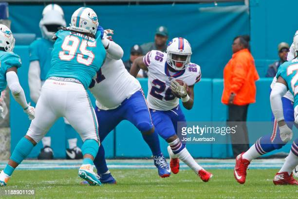 Devin Singletary of the Buffalo Bills runs with the ball against the Miami Dolphins during an NFL game on November 17, 2019 at Hard Rock Stadium in...
