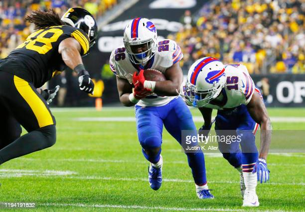 Devin Singletary of the Buffalo Bills runs with the ball during the first half against the Pittsburgh Steelers in the game at Heinz Field on December...