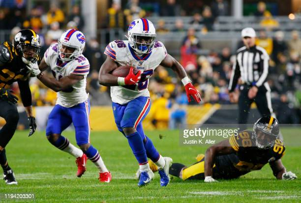 Devin Singletary of the Buffalo Bills runs with the ball during the second half against the Pittsburgh Steelers in the game at Heinz Field on...