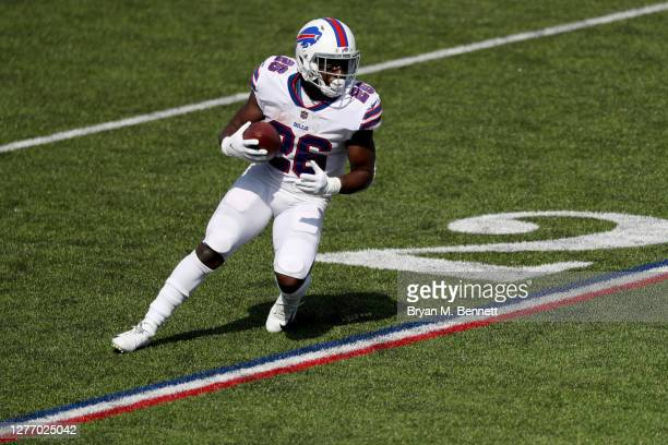 Devin Singletary of the Buffalo Bills runs with the ball during the first quarter against the Los Angeles Rams at Bills Stadium on September 27, 2020...