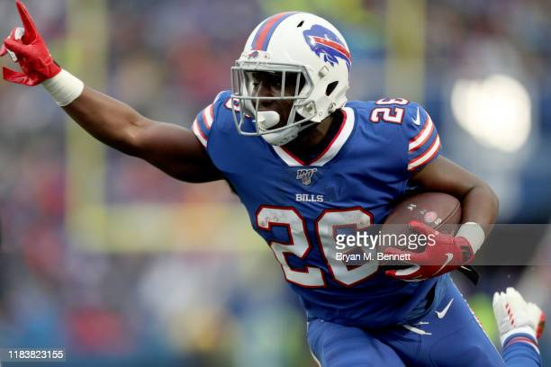 Devin Singletary of the Buffalo Bills signals while scoring a touchdown off of a pass from Josh Allen of the Buffalo Bills during the third quarter...