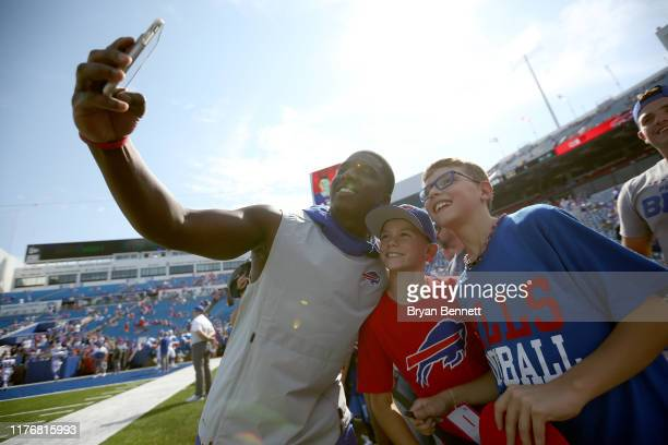 Devin Singletary of the Buffalo Bills takes picture with fans before a game against the Cincinnati Bengals at New Era Field on September 22 2019 in...