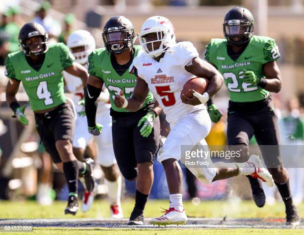 Devin Singletary of the Florida Atlantic Owls carries during the Conference USA Championship game against the North Texas Mean Green at FAU Stadium...