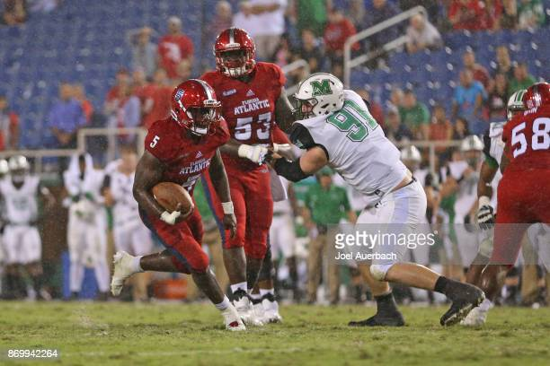 Devin Singletary of the Florida Atlantic Owls runs for a fourth quarter touchdown against the Marshall Thundering Herd at FAU Stadium on November 3...