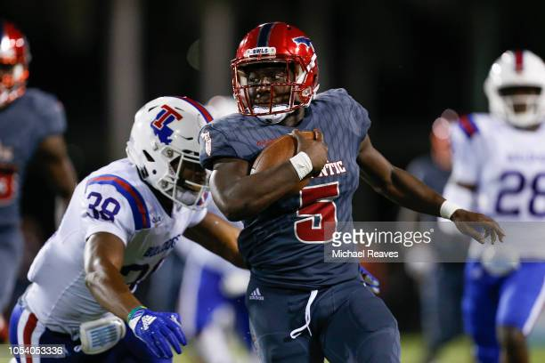 Devin Singletary of the Florida Atlantic Owls runs with the ball against Darryl Lewis of the Louisiana Tech Bulldogs during the second half at FAU...
