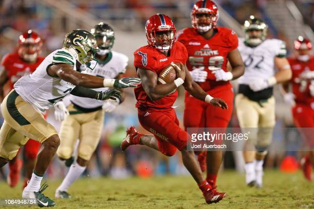 Devin Singletary of the Florida Atlantic Owls runs with the ball against the Charlotte 49ers on November 24 2018 at FAU Stadium in Boca Raton Florida