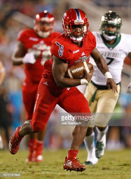 Devin Singletary of the Florida Atlantic Owls runs with the ball against the Charlotte 49ers on November 24 2018 at FAU Stadium in Boca Raton Florida...