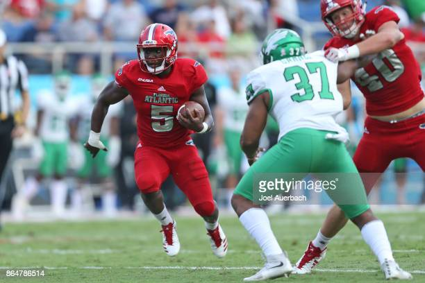 Devin Singletary of the Florida Atlantic Owls runs with the ball against the North Texas Mean Green during first half action on October 21 2017 at...