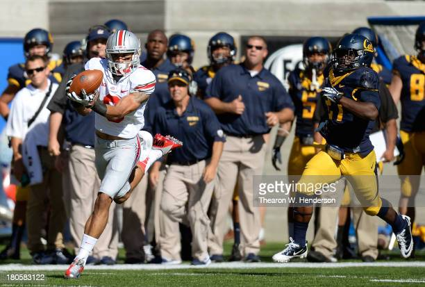 Devin Smith of the Ohio State Buckeyes catches a 91-yard touchdown pass over Damariay Drew of the California Golden Bears during the first quarter of...