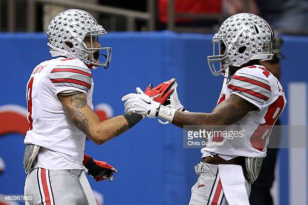 Devin Smith of the Ohio State Buckeyes celebrates with Corey Smith after scoring a 47 yard touchdown pass in the third quarter against the Alabama...