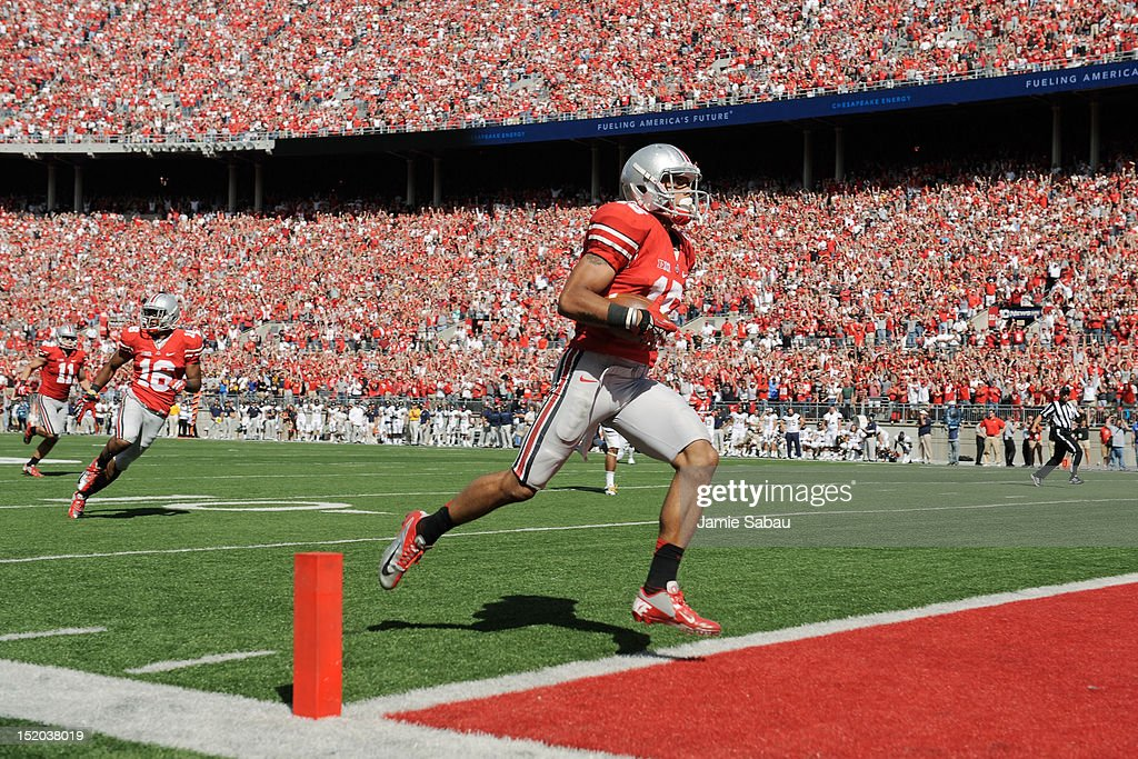 Devin Smith #15 of the Ohio State Buckeyes crosses the goal line to complete a 72-yard touchdown reception against the California Golden Bears in the fourth quarter at Ohio Stadium on September 15, 2012 in Columbus, Ohio. The touchdown would prove to be the game winner as the Buckeyes topped the Golden Bears 35-28.
