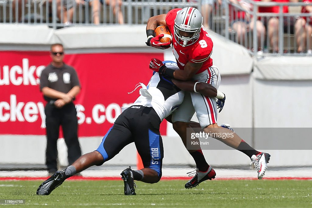 Devin Smith #9 of the Ohio State Buckeyes is tackled by Derek Brim #15 of the Buffalo Bulls during the first half on August 31, 2013 at Ohio Stadium in Columbus, Ohio.
