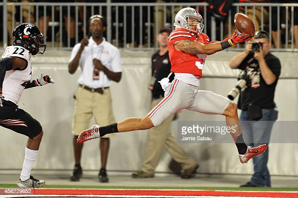Devin Smith of the Ohio State Buckeyes makes a 34yard touchdown catch in the fourth quarter in front of Zach Edwards of the Cincinnati Bearcats at...