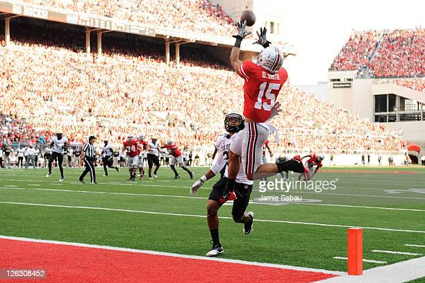 Devin Smith of the Ohio State Buckeyes pulls in a 17yard touchdown catch over Greg Henderson of the Colorado Buffaloes in the third quarter at Ohio...