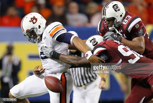 Devin Taylor and Cliff Matthews of the South Carolina Gamecocks force a fumble by quarterback Cam Newton of the Auburn Tigers during the 2010 SEC...