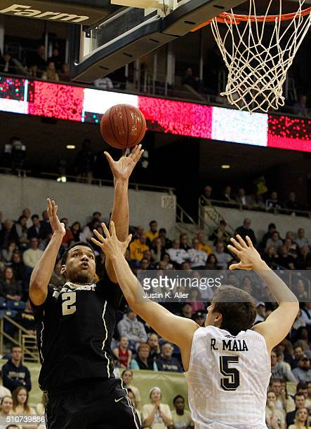 Devin Thomas of the Wake Forest Demon Deacons pulls up for a shot against Rafael Maia of the Pittsburgh Panthers in the second half during the game...